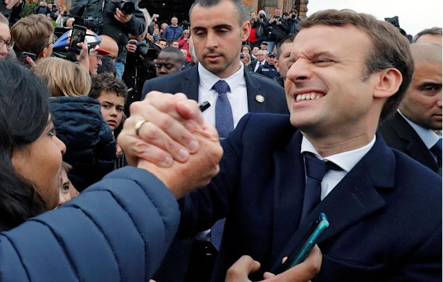 <p>French presidential candidate Emmanuel Macron greeted supporters as he left a polling station during the the second round of the French presidential election, in Le Touquet, France, May 7, 2017. (Philippe Wojazer/Reuters) </p>