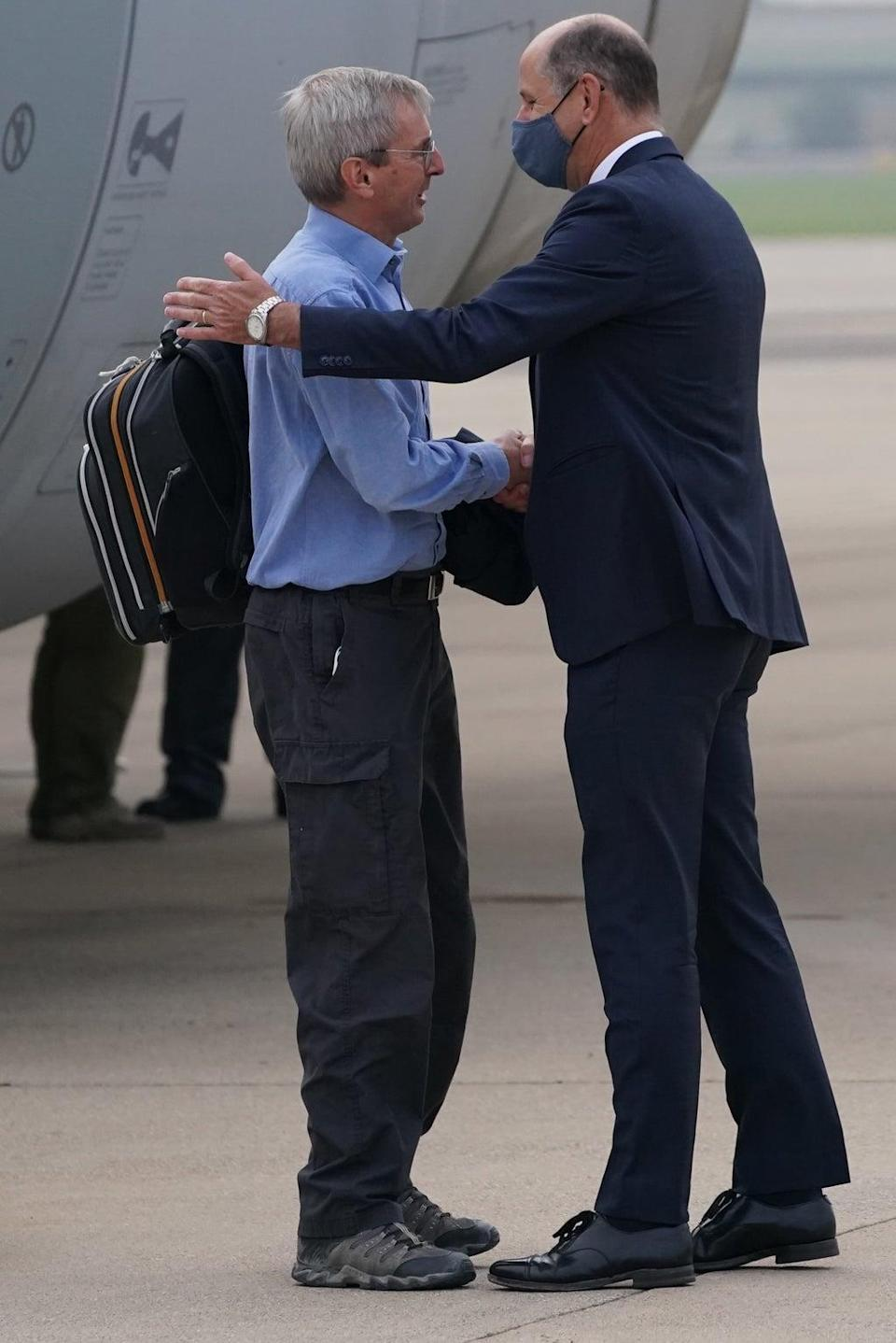 Ambassador to Afghanistan Sir Laurie Bristow, left, is greeted by Sir Philip Barton, Permanent Under-Secretary of the Foreign, Commonwealth and Development Office at RAF Brize Norton (Jonathan Brady/PA) (PA Wire)