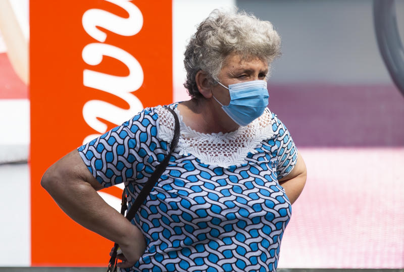 An old woman with mask walks through the city during the new Coronavirus disease (COVID-19) after the increase of coronavirus infected in Belgrade, Serbia on July 24, 2020. The number of coronavirus infections is increasing throughout Serbia, especially in Belgrade, where 80% of coronavirus infections are found. The government mandates the mandatory use of masks indoors and outdoors to halt the spread of the coronavirus disease (COVID-19). (Photo by Nikola Krstic/NurPhoto via Getty Images)
