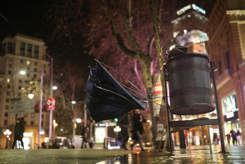 """Broken umbrellas are pictured on a waste bin during the storm """"Gloria"""" on a street in Barcelona"""