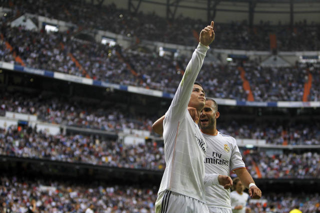Real Madrid's Cristiano Ronaldo, left, celebrates his goal with teammate Jese Rodriguez, right, during a Spanish La Liga soccer match against Malaga at the Santiago Bernabeu stadium in Madrid, Spain, Saturday, Oct. 19, 2013. (AP Photo/Andres Kudacki)