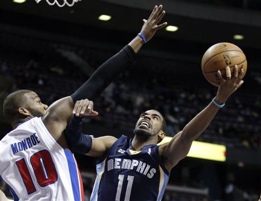Memphis Grizzlies guard Mike Conley (11) shoots against Detroit Pistons center Greg Monroe (10) in the first half of an NBA basketball game Tuesday, Feb. 19, 2013, in Auburn Hills, Mich. (AP Photo/Duane Burleson)