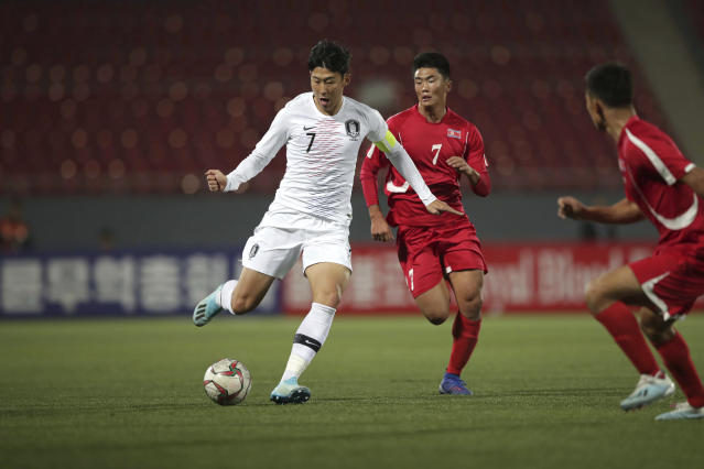 FILE - In this Oct. 15, 2019, file photo provided by the Korea Football Association, South Korea's Son Heung-min, left, fights for the ball against North Korea's Han Kwang Song during their Asian zone Group H qualifying soccer match for the 2022 World Cup at Kim Il Sung Stadium in Pyongyang, North Korea. The South Korean soccer association said Friday, Oct. 18, it has requested that North Korea be punished for blocking rival fans and media from attending a World Cup qualifier between the countries at an empty stadium in Pyongyang. (The Korea Football Association via AP, File)