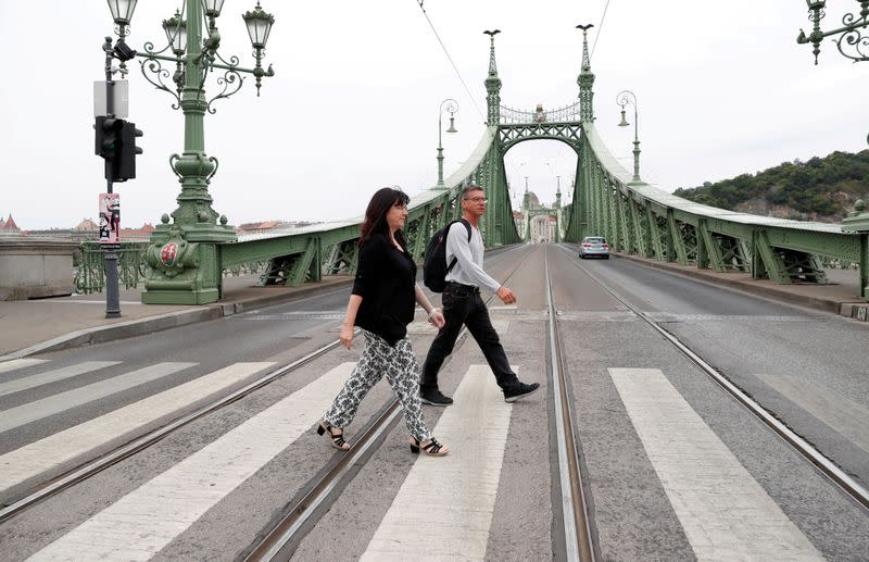 FILE PHOTO: Passengers from Germany walk during a sightseeing in Budapest