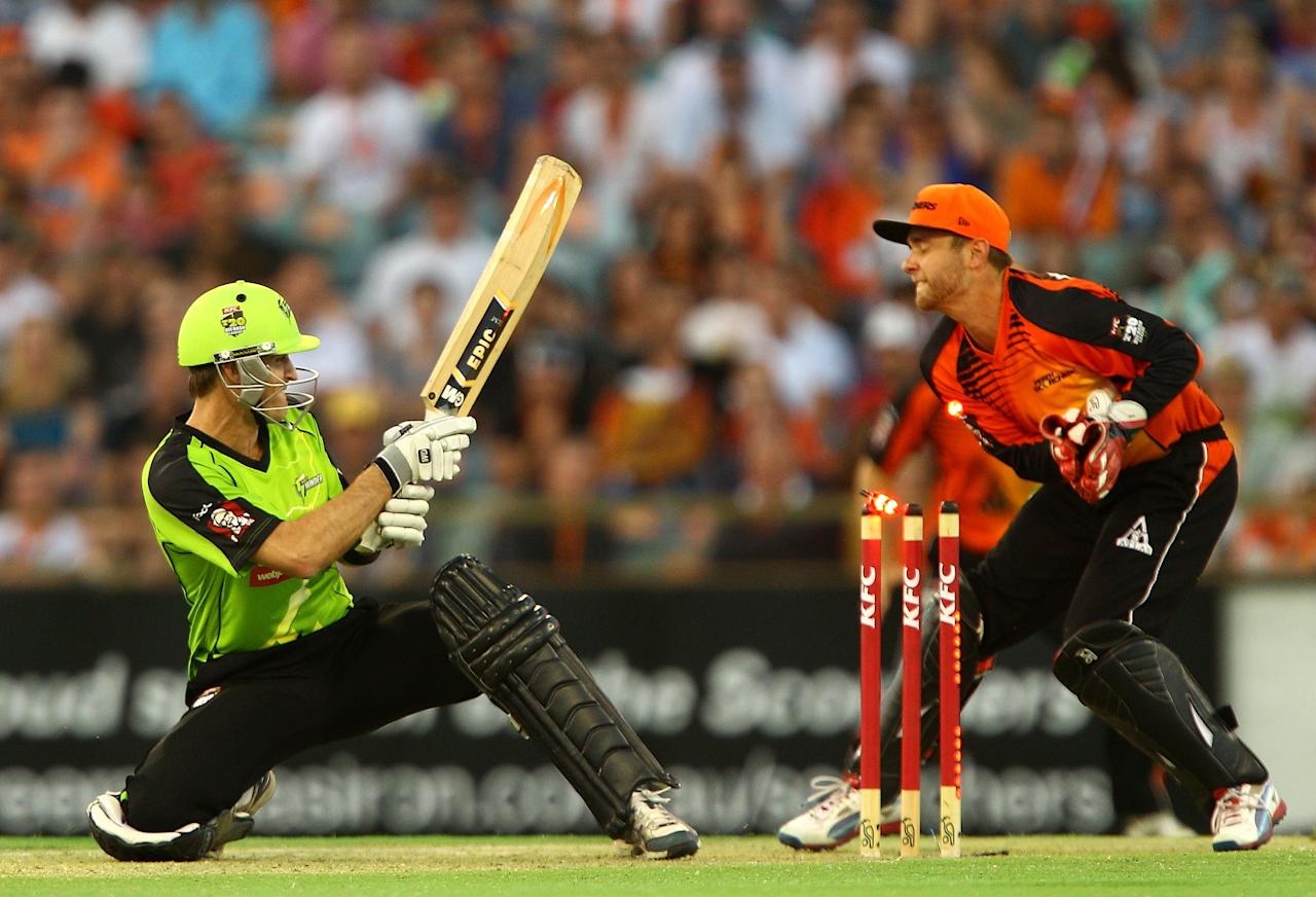 PERTH, AUSTRALIA - JANUARY 04: Cameron Borgas of the Thunder gets bowled by Brad Hogg of the Scorchers during the Big Bash League match between the Perth Scorchers and the Sydney Thunder at WACA on January 4, 2013 in Perth, Australia.  (Photo by Paul Kane/Getty Images)