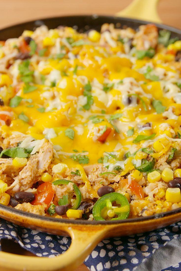 """<p>With chopped tomatoes, jalapeños, black beans, and cumin, this flavorful chicken and cauliflower rice skillet channels some serious Tex-Mex vibes. </p><p>Get the recipe from <a href=""""https://www.delish.com/cooking/recipe-ideas/recipes/a51950/cheesy-tex-mex-cauli-rice/"""" rel=""""nofollow noopener"""" target=""""_blank"""" data-ylk=""""slk:Delish"""" class=""""link rapid-noclick-resp"""">Delish</a>.</p>"""