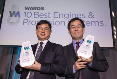 Dr. Kyoung Pyo Ha (right), Research Fellow, Hyundai Motor Group and Dr. Jin Hwan Jung (left), Electrification Group Leader, Hyundai Motor Group receive trophies for Hyundai 2020 Sonata's Smartstream 1.6L Turbocharged-GDi engine and 2020 Kona Electric's powertrain from WardsAuto.