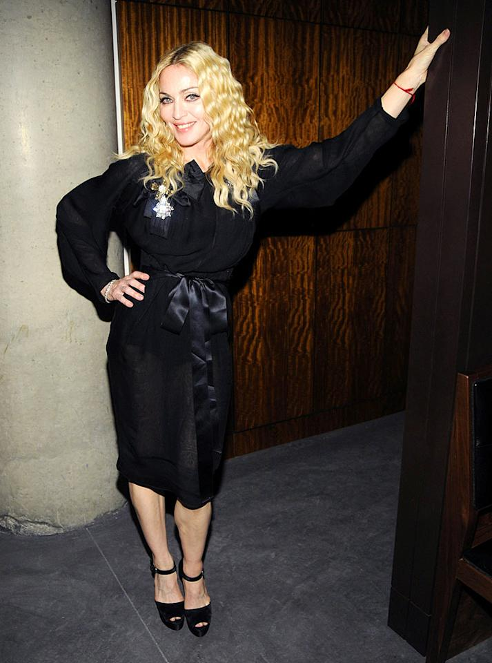 "Just two days after her own directorial debut, Madonna and husband Guy Richie announced their plans to divorce. On Saturday, the U.K. publication The Sun claimed the two had reached a divorce settlement, in which Ritchie will reportedly walk away with assets totaling around $60 million. Kevin Mazur/<a href=""http://www.wireimage.com"" target=""new"">WireImage.com</a> - October 13, 2008"