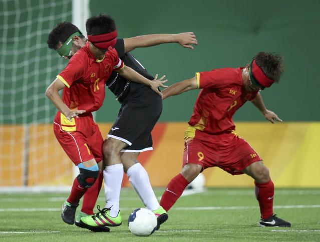 2016 Rio Paralympics - Football Soccer - Men's 5-a-side Preliminaries Pool B - China v Mexico - Olympic Tennis Centre - Rio de Janeiro, Brazil - 11/09/2016. Wang Yafeng and Wang Zhoubin (CHN) of China in action with Jorge Lanzagorta (MEX) of Mexico. REUTERS/Ueslei Marcelino FOR EDITORIAL USE ONLY, NOT FOR SALE FOR MARKETING OR ADVERTISING CAMPAIGNS.