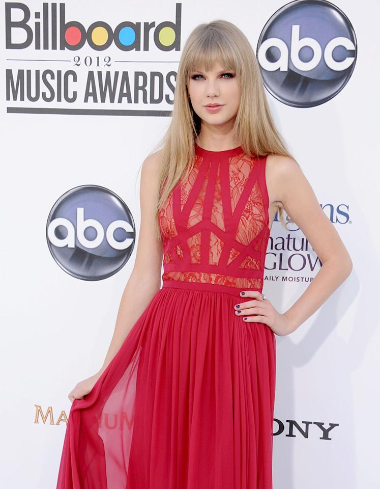 "Taylor Swift, who is nominated for a Golden Globe for ""Safe & Sound,"" wore a red-hot gown -- with carefully placed sheer panels -- to the 2012 Billboard Music Awards."