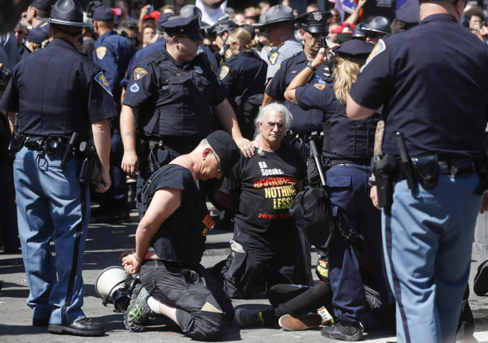 <p>Law enforcement officers take protesters into custody, July 20, 2016, in Cleveland, during the third day of the Republican convention. (Photo: John Minchillo/AP)</p>