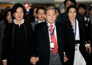 FILE PHOTO: Former Samsung Electronics Chairman Lee tours the CES with his wife and daughter in Las Vegas