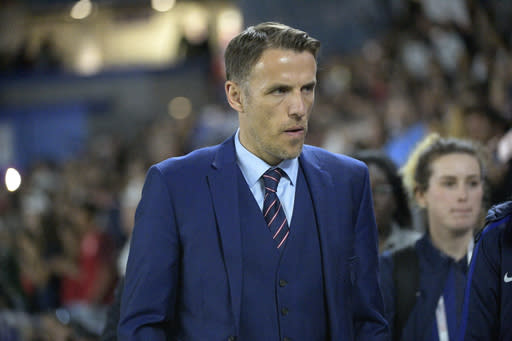 FILE - In this Wednesday, March 7, 2018 file photo, England head coach Phil Neville walks onto the field before a SheBelieves Cup women's soccer match against the United States, in Orlando, Fla. Neville is leaving his job as coach of England's women's team ahead of an anticipated switch to mens soccer in the United States, it was announced Monday, Jan. 18, 2021. The Football Association has released Neville from his contract immediately after being informed he was in talks to become coach of Inter Miami, the Major League Soccer franchise partly owned by David Beckham. (AP Photo/Phelan M. Ebenhack, file)