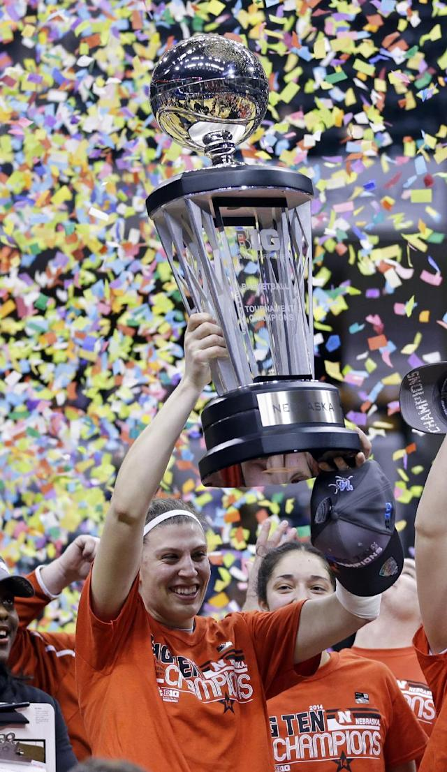 Nebraska forward Jordan Hooper hoist the championship trophy after defeating Iowa in an NCAA college basketball game in the finals of the Big Ten women's tournament in Indianapolis, Sunday, March 9, 2014. Nebraska won 72-65. (AP Photo/Michael Conroy)