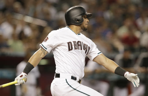 Arizona Diamondbacks' David Peralta watches his RBI triple against the Pittsburgh Pirates during the third inning of a baseball game Tuesday, June 12, 2018, in Phoenix. (AP Photo/Rick Scuteri)