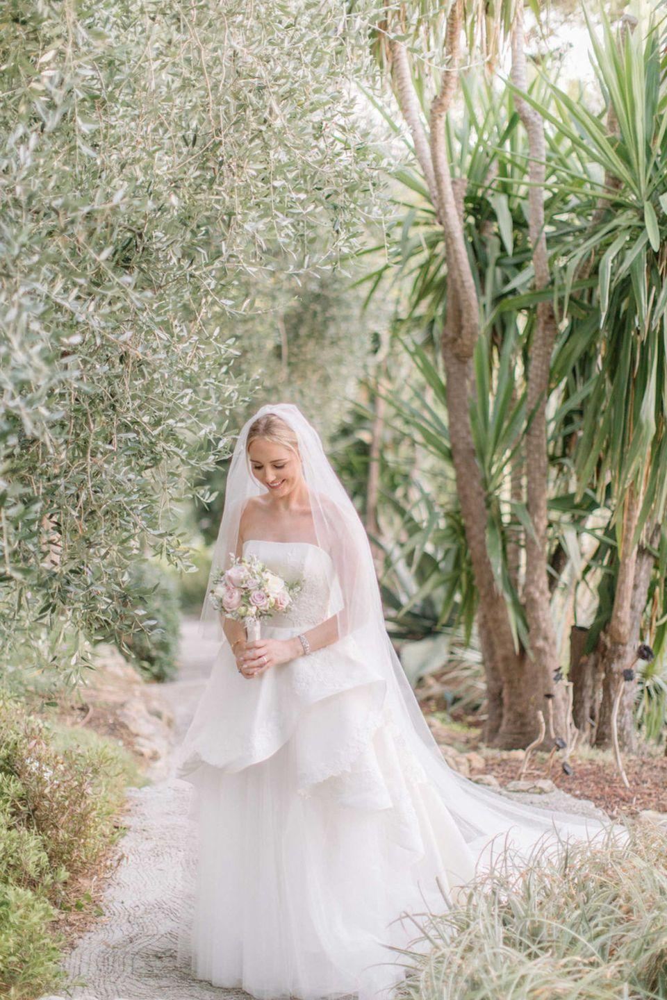 <p><strong>Wedding dress and veil:</strong> Caroline Castigliano </p><p><strong>Bracelet:</strong> Vintage Cartier, kindly lent by G Collins & Sons</p><p><strong>Earrings and ring:</strong> G Collins & Sons</p><p><strong>Shoes:</strong> Prada</p>