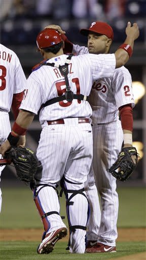 Philadelphia Phillies' Placido Polanco, right, and Carlos Ruiz celebrate after a baseball game against the Chicago Cubs, Monday, April 30, 2012, in Philadelphia. Philadelphia won 6-4. (AP Photo/Matt Slocum)