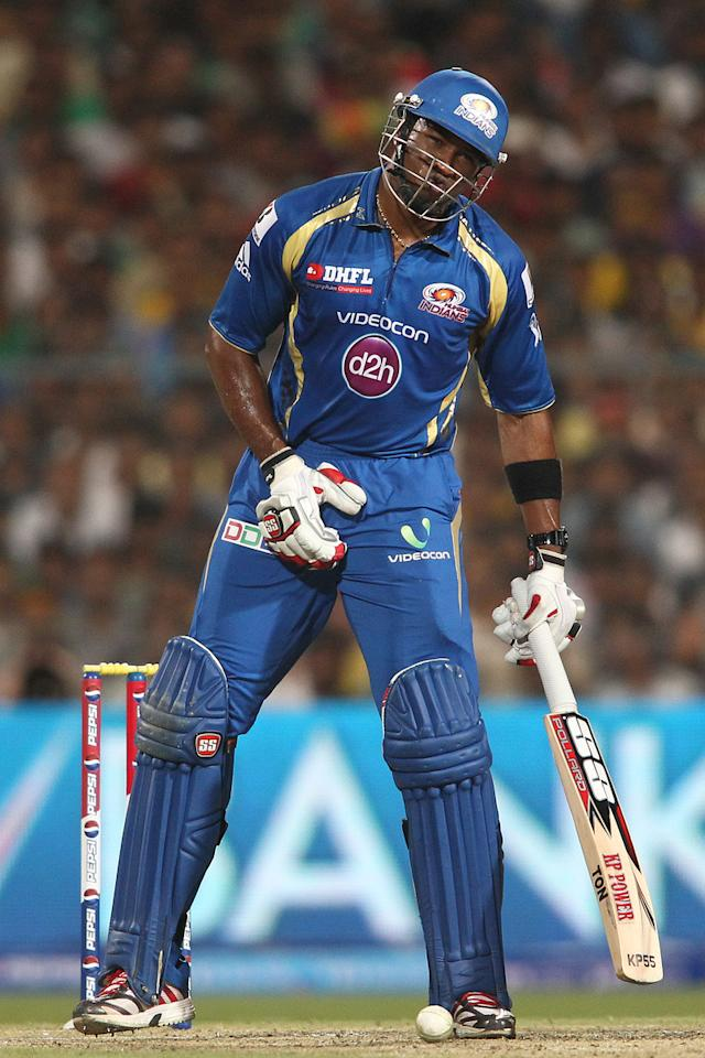 Kieron Pollard of Mumbai Indians reacts after being hit in the midriff area during the Final of the Pepsi Indian Premier League between The Chennai Superkings and the Mumbai Indians held at the Eden Gardens Stadium in Kolkata on the 26th May 2013..Photo by Saikat Das-IPL-SPORTZPICS       ..Use of this image is subject to the terms and conditions as outlined by the BCCI. These terms can be found by following this link:..https://ec.yimg.com/ec?url=http%3a%2f%2fwww.sportzpics.co.za%2fimage%2fI0000SoRagM2cIEc&t=1500921957&sig=LYRGUldwPaEVVEYDzz15Uw--~C