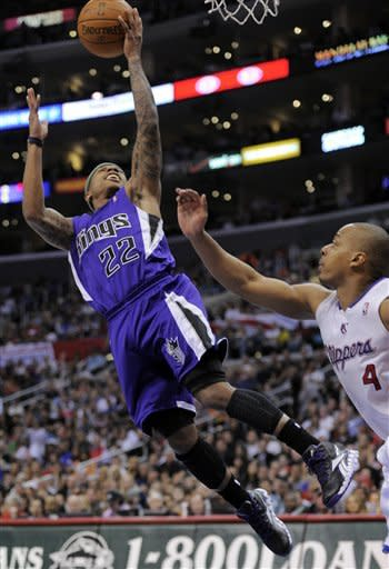 Sacramento Kings guard Isaiah Thomas, left, puts up a shot as Los Angeles Clippers guard Randy Foye defends during the first half of their NBA basketball game, Saturday, April 7, 2012, in Los Angeles. (AP Photo/Mark J. Terrill)