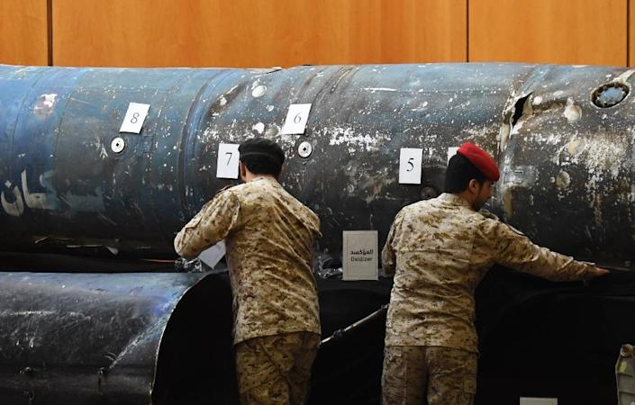 Saudi soldiers reveal the remains of missiles fired from Yemen on the kingdom; a confidential UN report says that debris it examined from five missiles were made in Iran but officials could not determine when they were sent to Yemen (AFP Photo/FAYEZ NURELDINE)