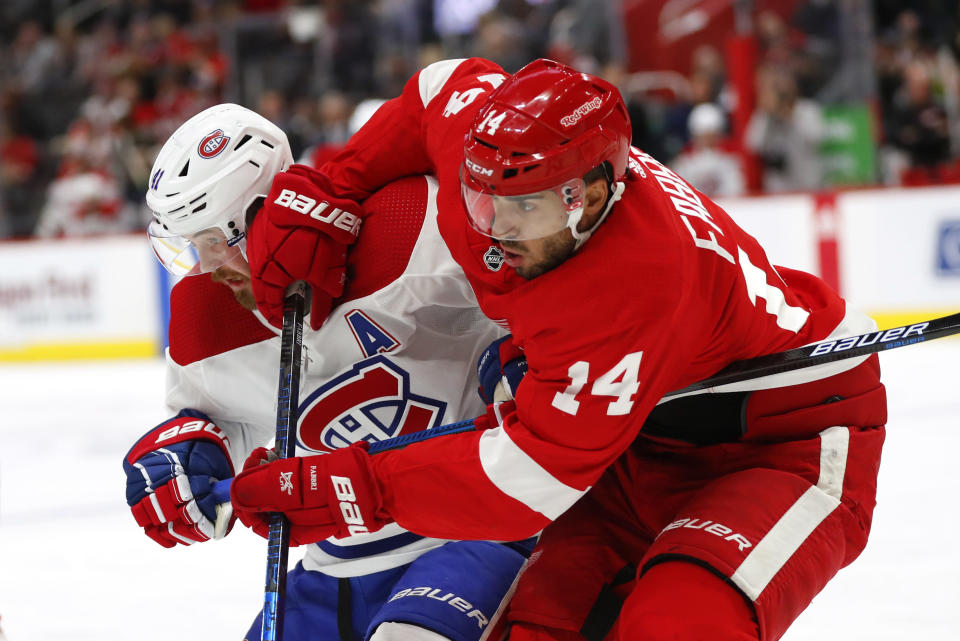 Montreal Canadiens left wing Paul Byron, left, and Detroit Red Wings center Robby Fabbri vie for position during the first period of an NHL hockey game Tuesday, Feb. 18, 2020, in Detroit. (AP Photo/Paul Sancya)