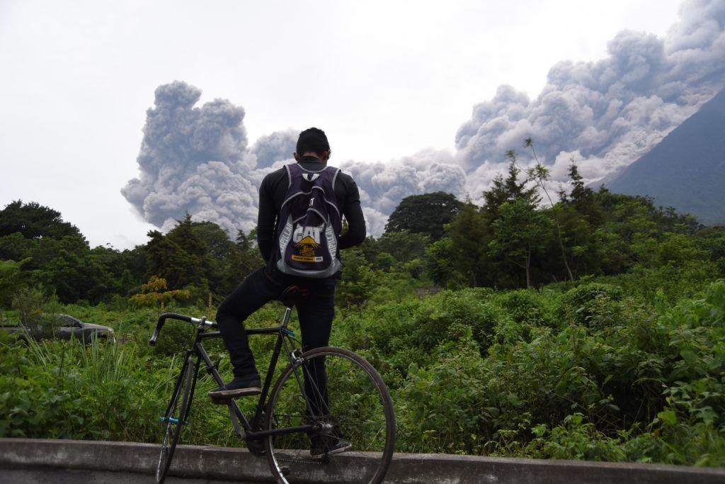 <p></p><p>A man looks at the Fuego Volcano in eruption, from Alotenango municipality, Sacatepequez department. (Getty) </p><p></p>