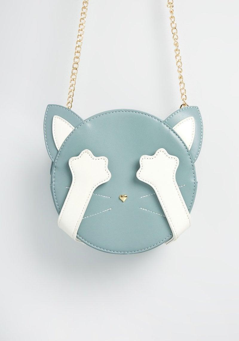 <p>With a removable gold chain strap and top zip closure, the <span>I Cat-not See You Crossbody Bag</span> ($50, originally $55) is such a cute everyday bag that will turn heads. If your bestie is a cat lover, they'll absolutely adore this one-of-a-kind bag.</p>