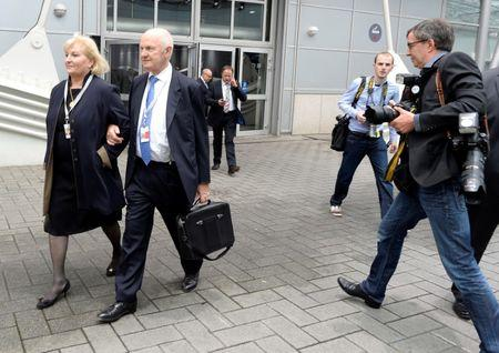 FILE PHOTO - Piech, chairman of the supervisory board of German carmaker Volkswagen and his wife Ursula, member of the board of VW, arrive at the annual shareholders meeting in Hanover