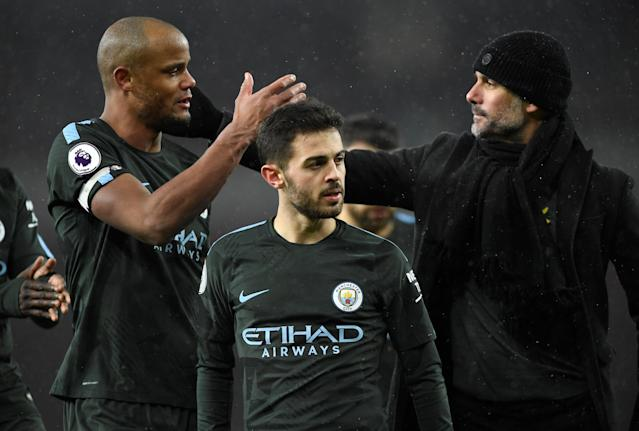 """Soccer Football - Premier League - Arsenal vs Manchester City - Emirates Stadium, London, Britain - March 1, 2018 Manchester City manager Pep Guardiola celebrates with Vincent Kompany after the match Action Images via Reuters/Tony O'Brien EDITORIAL USE ONLY. No use with unauthorized audio, video, data, fixture lists, club/league logos or """"live"""" services. Online in-match use limited to 75 images, no video emulation. No use in betting, games or single club/league/player publications. Please contact your account representative for further details."""