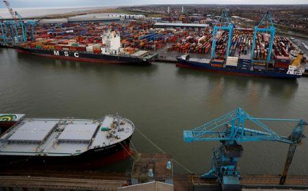 FILE PHOTO: A container ship is unloaded at Peel Ports Liverpool container terminal in Liverpool