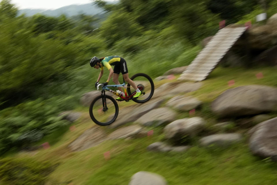 Jaqueline Mourao of Brazil competes during the women's cross-country mountain bike competition at the 2020 Summer Olympics, Tuesday, July 27, 2021, in Izu, Japan. (AP Photo/Christophe Ena)