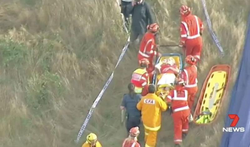 A woman is stretchered away after the accident. Source: 7 News