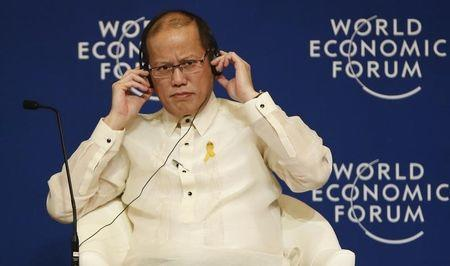 Philippine President Benigno Aquino listens on his headset during the opening session of World Economic forum in Manila