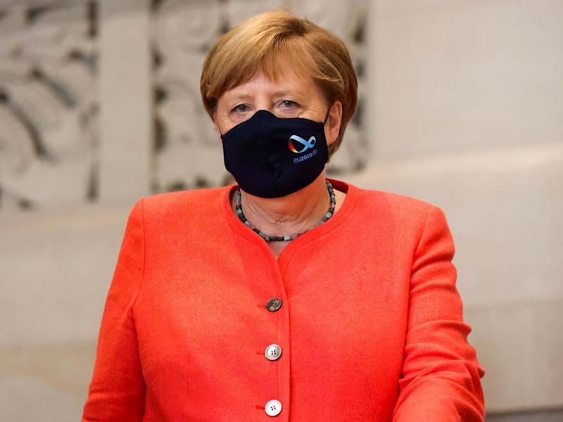 German Chancellor Angela Merkel wearing a face mask leaves after a session at the upper house of the German parliament Bundesrat: REUTERS
