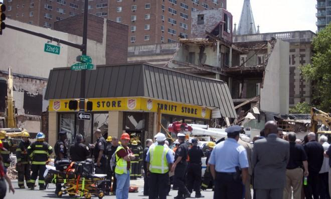 Rescue workers search for victims after a building at a demolition site collapsed in an apparent accident on June 5 in Philadelphia.