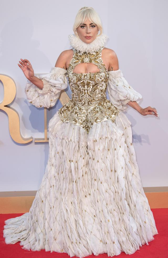 <p>Lady Gaga was no shrinking violet at the premiere of 'A Star Is Born' in London, wearing a decadent Victoriana dress complete with a neck cuff. <br>[Photo: Rex] </p>