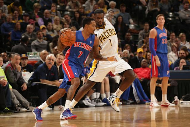 INDIANAPOLIS - DECEMBER 16: Brandon Jennings #7 of the Detroit Pistons drives against Lance Stephenson #1 of the Indiana Pacers at Bankers Life Fieldhouse on December 16, 2013 in Indianapolis, Indiana. (Photo by Ron Hoskins/NBAE via Getty Images)