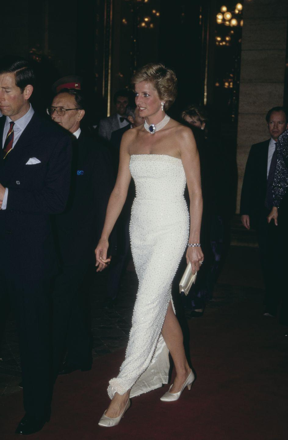 <p>For a dinner in Hungary in 1990, Princess Diana accessorized her Catherine Walker gown with her beloved sapphire and pearl choker. </p>