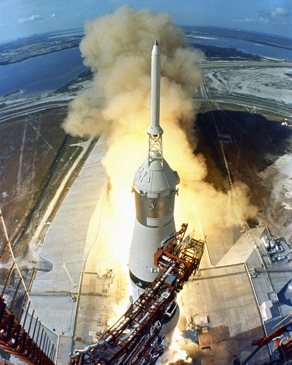 At 9:32 a.m. EDT, the swing arms move away and a plume of flame signals the liftoff of the Apollo 11 Saturn V space vehicle and astronauts Neil A. Armstrong, Michael Collins and Edwin E. Aldrin, Jr. from Kennedy Space Center Launch Complex 39A. (Photo: VCG Wilson/Corbis via Getty Images)