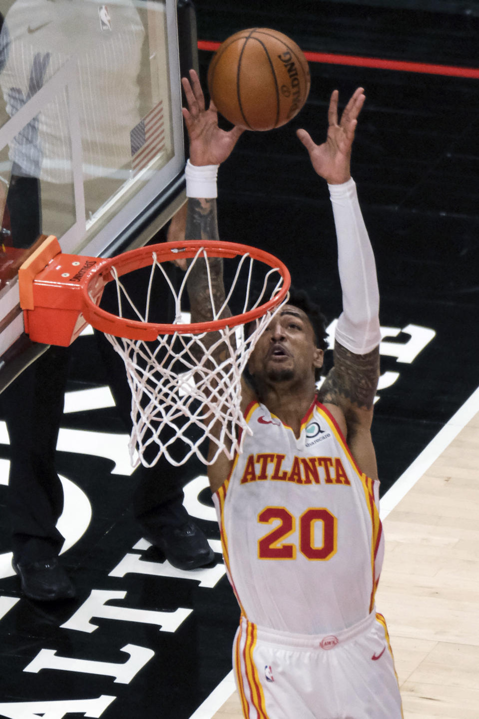 Atlanta Hawks forward John Collins (20) catches the ball for a dunk during the second half of an NBA basketball game against the Milwaukee Bucks on Sunday, April 25, 2021, in Atlanta. (AP Photo/Ben Gray)