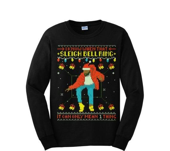 "<p>Any Drake fan can stay warm and toasty in this <a href=""https://www.popsugar.com/buy/Hotline-Bling-Ugly-Christmas-Long-Sleeve-Shirt-389727?p_name=%22Hotline%20Bling%22%20Ugly%20Christmas%20Long-Sleeve%20Shirt&retailer=etsy.com&pid=389727&price=15&evar1=pop%3Aus&evar9=39895241&evar98=https%3A%2F%2Fwww.popsugar.com%2Fphoto-gallery%2F39895241%2Fimage%2F45501746%2FUgly-Christmas-Long-Sleeve-Shirt&list1=gifts%2Cgift%20guide%2Cdrake&prop13=api&pdata=1"" rel=""nofollow"" data-shoppable-link=""1"" target=""_blank"" class=""ga-track"" data-ga-category=""Related"" data-ga-label=""https://www.etsy.com/listing/489759523/drake-ugly-christmas-sweater-style-long"" data-ga-action=""In-Line Links"">""Hotline Bling"" Ugly Christmas Long-Sleeve Shirt</a> ($15) while they dance to the rapper's greatest hits.</p>"