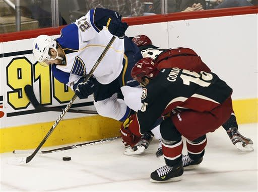 St. Louis Blues' Alex Pietrangelo (27) battles Phoenix Coyotes' Boyd Gordon, right, for the puck during the second period of an NHL hockey game, Friday, Dec. 23, 2011, in Glendale, Ariz. (AP Photo/Matt York)