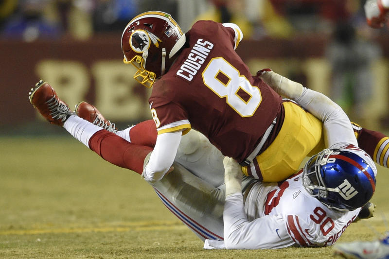 Jason Pierre-Paul had 8.5 sacks last season, including this one of Washington's Kirk Cousins. (AP)