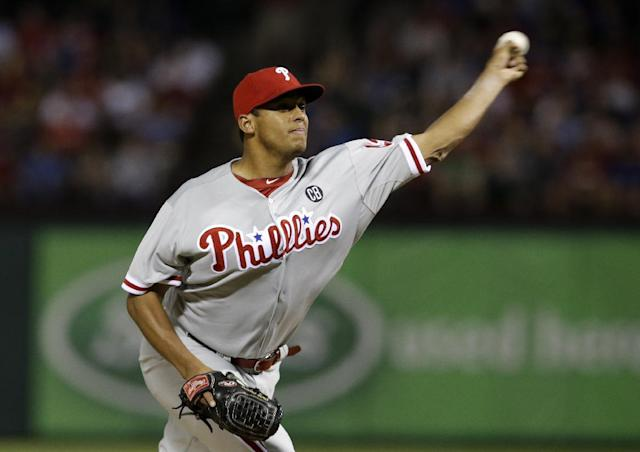 Philadelphia Phillies relief pitcher Mario Hollands works against the Texas Rangers in the ninth inning of a baseball game, Tuesday, April 1, 2014, in Arlington, Texas. Hollands made his major league debut in the 3-2 Rangers win. (AP Photo/Tony Gutierrez)