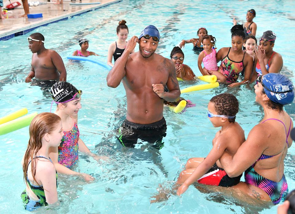 Cullen Jones, and Maritza Correia attend water safety and fitness at Carrie Steele Pitts Life Learning Center on April 30, 2016 in Atlanta, Georgia.