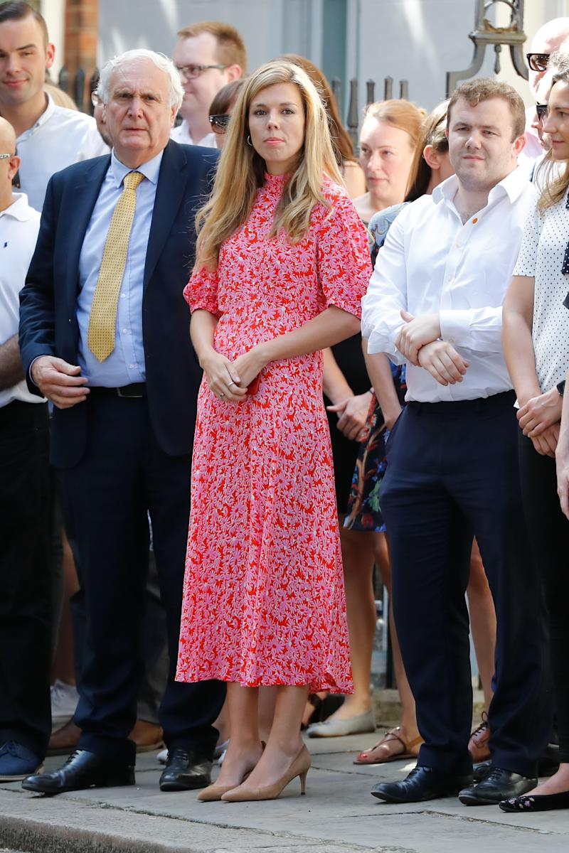 Carrie Symonds wearing a Ghost dress on Downing Street [Photo: Getty]
