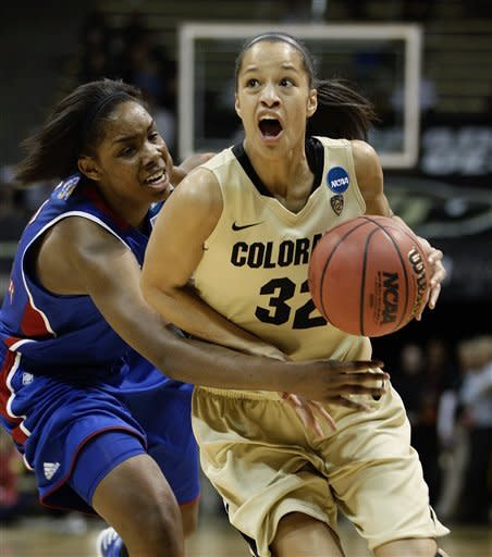 Colorado forward Arielle Roberson (32) is fouled by Kansas forward Chelsea Gardner while driving to the basket during the first half of a first-round women's NCAA college basketball game on Saturday, March 23, 2013, in Boulder, Colo. (AP Photo/Brennan Linsley )