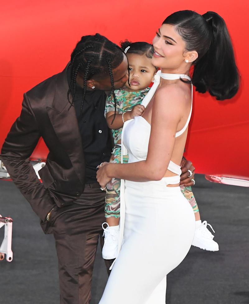"SANTA MONICA, CALIFORNIA - AUGUST 27: Travis Scott, Stormi Webster and Kylie Jenner attend the Premiere Of Netflix's ""Travis Scott: Look Mom I Can Fly"" at Barker Hangar on August 27, 2019 in Santa Monica, California. (Photo by Jon Kopaloff/FilmMagic)"
