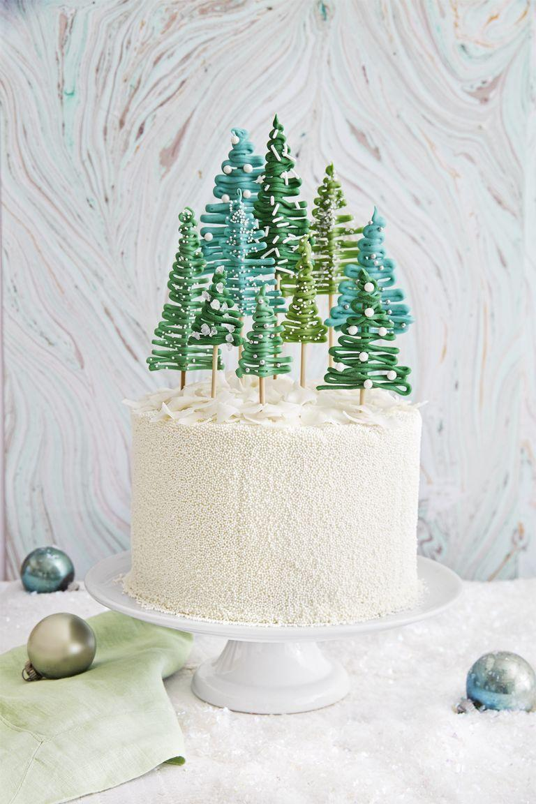 "<p>Use any cake recipe you like (or try ours!), then decorate with a forest of delicate frosting trees. Use this as your main cake for a small wedding or as the topper at a larger affair.</p><p><strong><a href=""https://www.countryliving.com/food-drinks/recipes/a40484/pine-tree-cake-recipe/"" rel=""nofollow noopener"" target=""_blank"" data-ylk=""slk:Get the recipe"" class=""link rapid-noclick-resp"">Get the recipe</a>.</strong></p>"