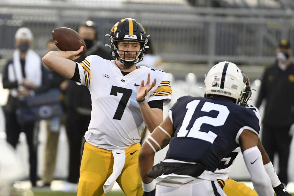Iowa quarterback Spencer Petras (7) passes as Penn State linebacker Brandon Smith (12) pursues during the first quarter of an NCAA college football game in State College, Pa., on Saturday, Nov. 21, 2020. (AP Photo/Barry Reeger)